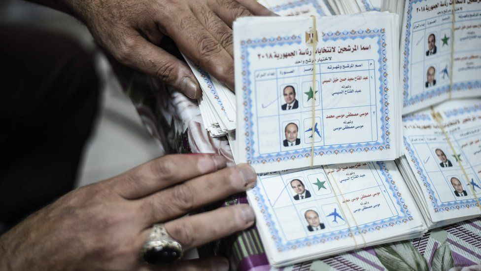 An electoral official counts ballots at a polling station in Cairo on 28 March 2018