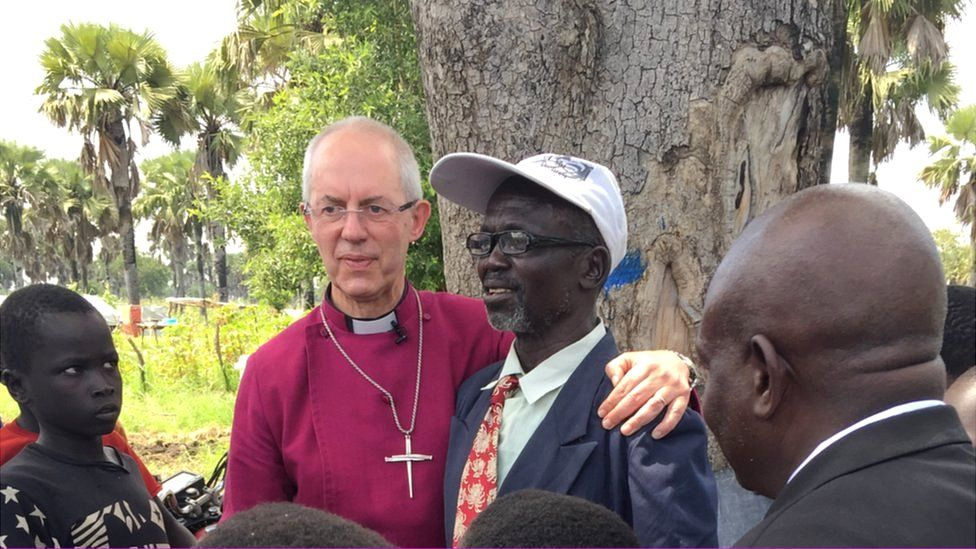 Justin Welby meets a teacher in a refugee camp in Moyo, Uganda