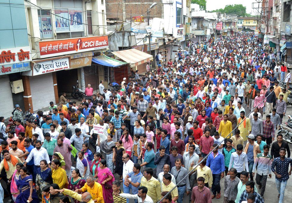 People participate in a rally to protest against the rape of a seven-year-old girl in Mandsaur.