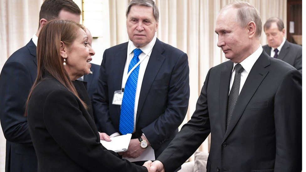 The mother of a jailed Israeli woman shakes hands with Russian President Vladimir Putin in Jerusalem
