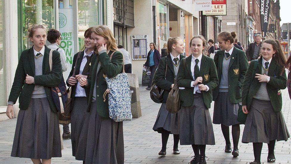 Teenager girls in school uniform