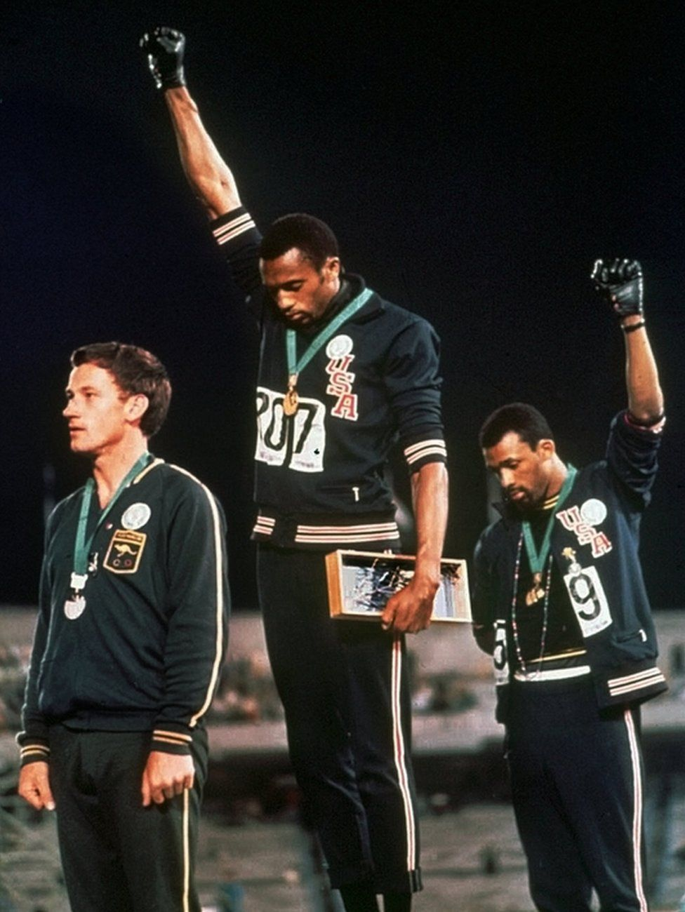 Tommie Smith, centre, and John Carlos during their protest at the 1968 Olympics