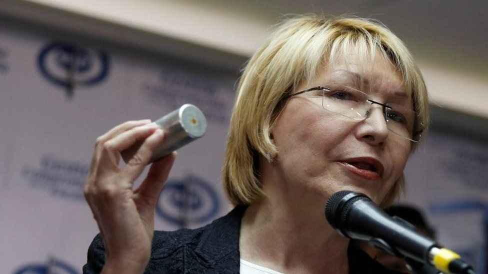 Venezuela's chief prosecutor Luisa Ortega Diaz holds a tear gas canister as she talks to the media during a news conference in Caracas, Venezuela May 24, 2017.