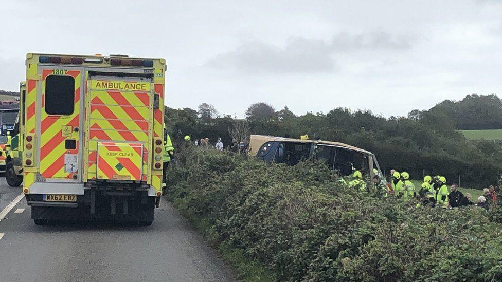 Overturned bus and ambulance.