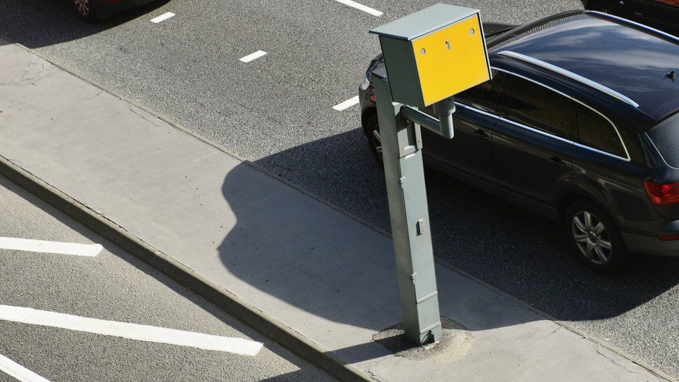 Car driving past speed camera