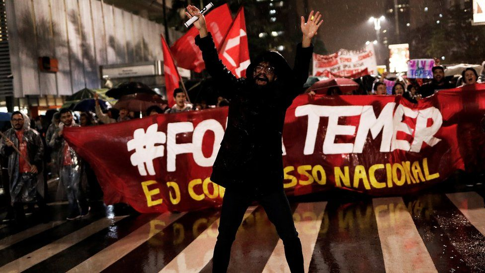 """Demonstrators take part in a protest against Brazil""""s President Michel Temer in Sao Paulo, Brazil on 18 May"""