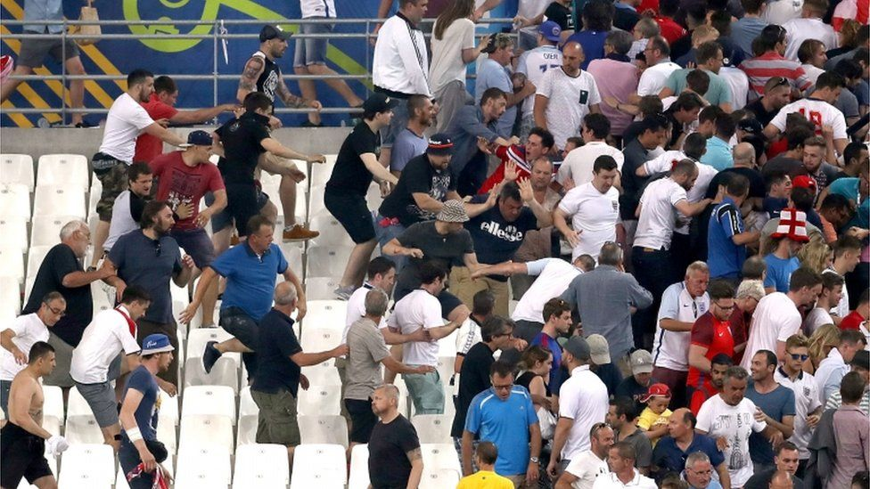 Russia fans, some wearing scarves over their faces, rushed towards England fans at the end of the match