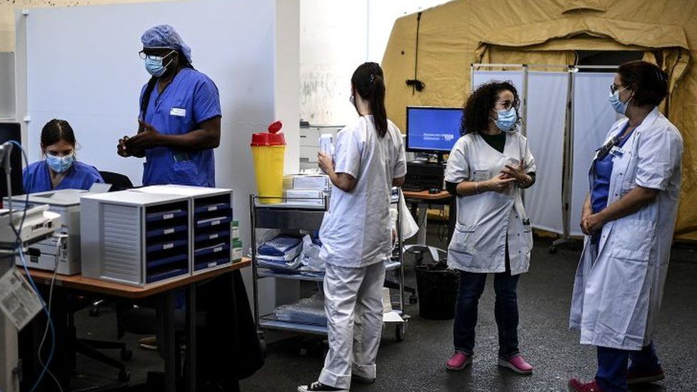 File photo of healthcare workers during the coronavirus pandemic in Paris