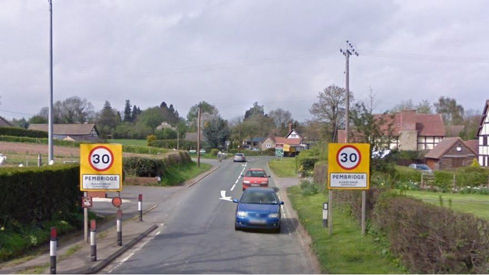 Signs on road into Pembridge