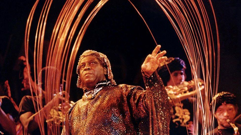 Sun Ra and his Sun Ra Archestra perform with a steel sculpture on September 23, 1978, at Hill Auditorium in Ann Arbor, Michigan.
