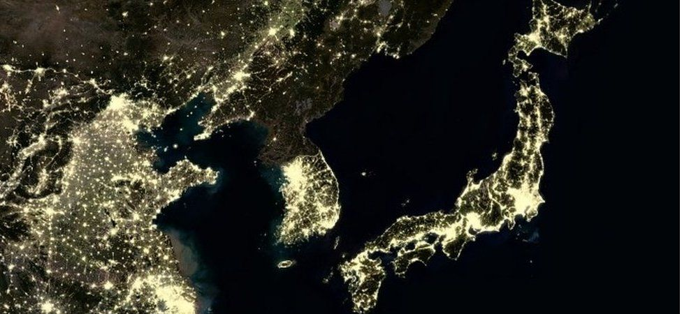 Night time satellite image showing North Korea with few artificial lights