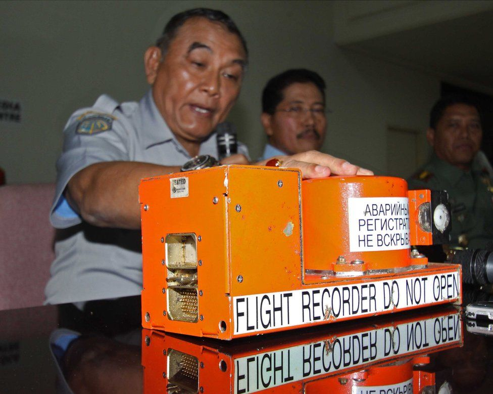 Indonesian officials give a press conference next to the flight data recorder of a crashed passenger jet on May 31, 2012.