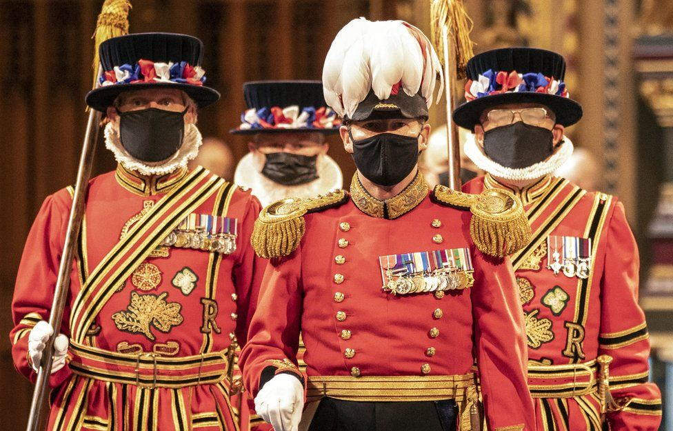 Masked Yeoman Warders march along the Royal Gallery during the ceremonial search of the Palace of Westminster in London