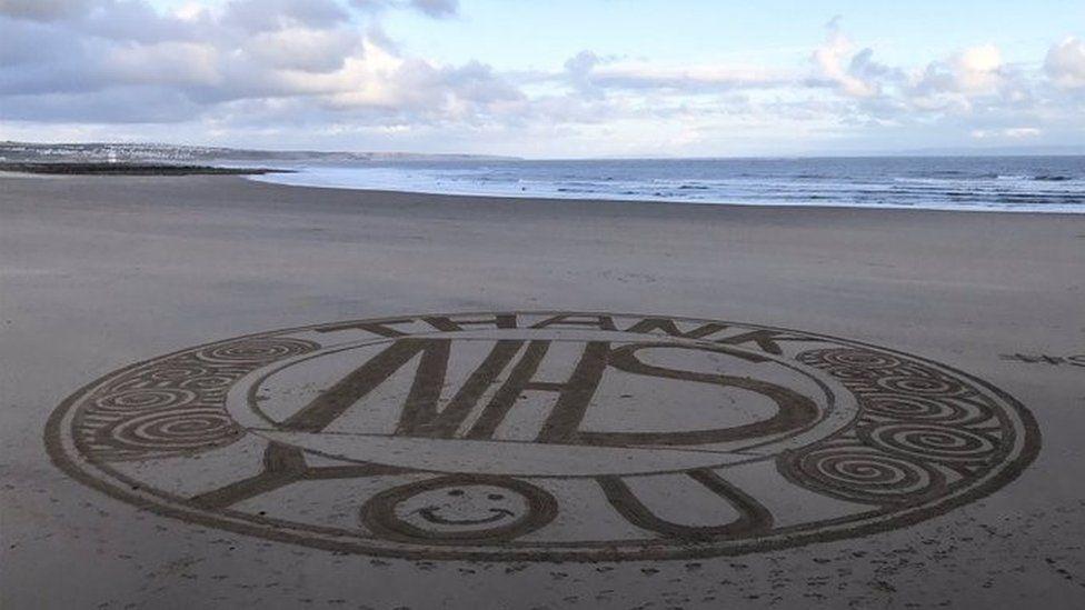 Sand art in Sandy Bay in Porthcawl