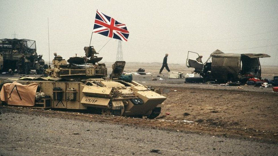 The British flag waves from an armored personnel carrier of the 7th Brigade Royal Scots as it advances along the Basra-Kuwait Highway