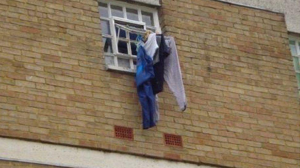 Prisoner's clothing drying outside cell
