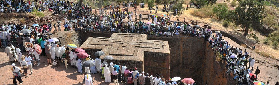 Ethiopian Orthodox Christian gather near to the rock-hewn church Bete Giyorgis during the annual festival of Timkat in Lalibela, Ethiopia which celebrates Epiphany, the Baptism of Jesus in the Jordan River, on 20 January 2012