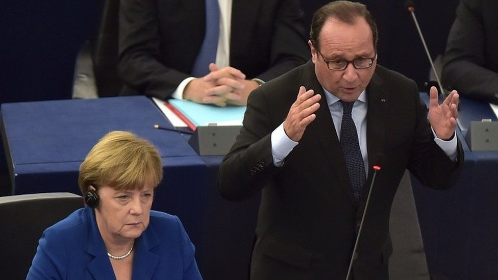 French President Francois Hollande (right) delivers a speech next to German Chancellor Angela Merkel (left) during their joint address at the European Parliament (07 October 2015)