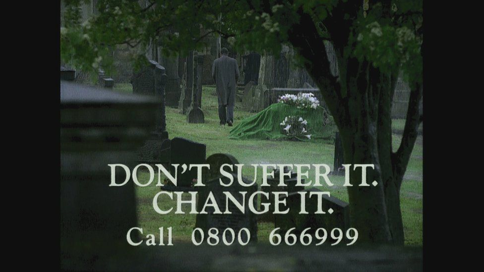 A man walking away from his sons grave in a NIO advert promoting the Confidential Telephone Line