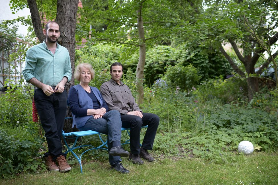 Hilde Schramm and her Syrian lodgers, Nizar and Ahmad