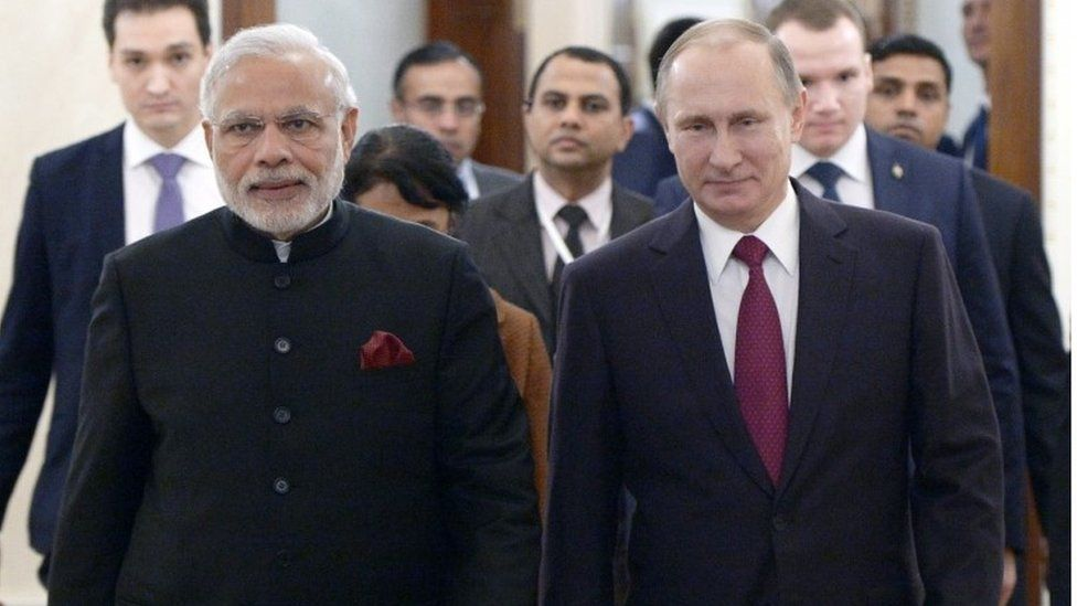 Russian President Vladimir Putin, right, and Indian Prime Minister Narendra Modi walk together during their meeting in the Kremlin in Moscow, Belarus, Wednesday, Dec. 23, 2015.