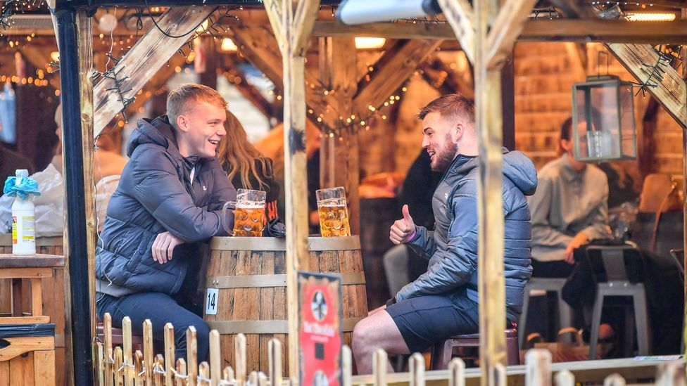Two people drinking in Cardiff