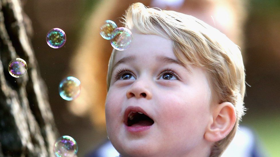 Prince George watches the bubbles