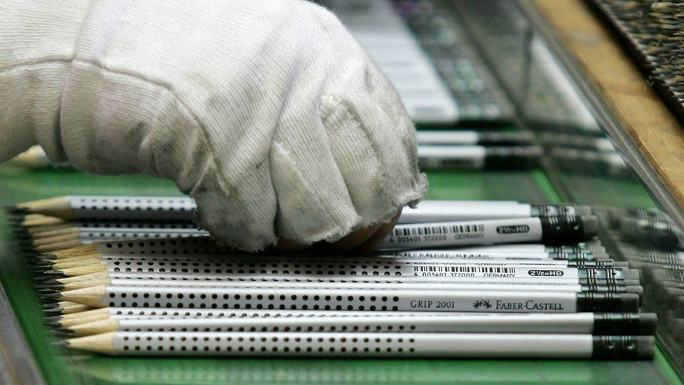 An employee checks finished lead pencils at the Faber-Castell plant in Germany