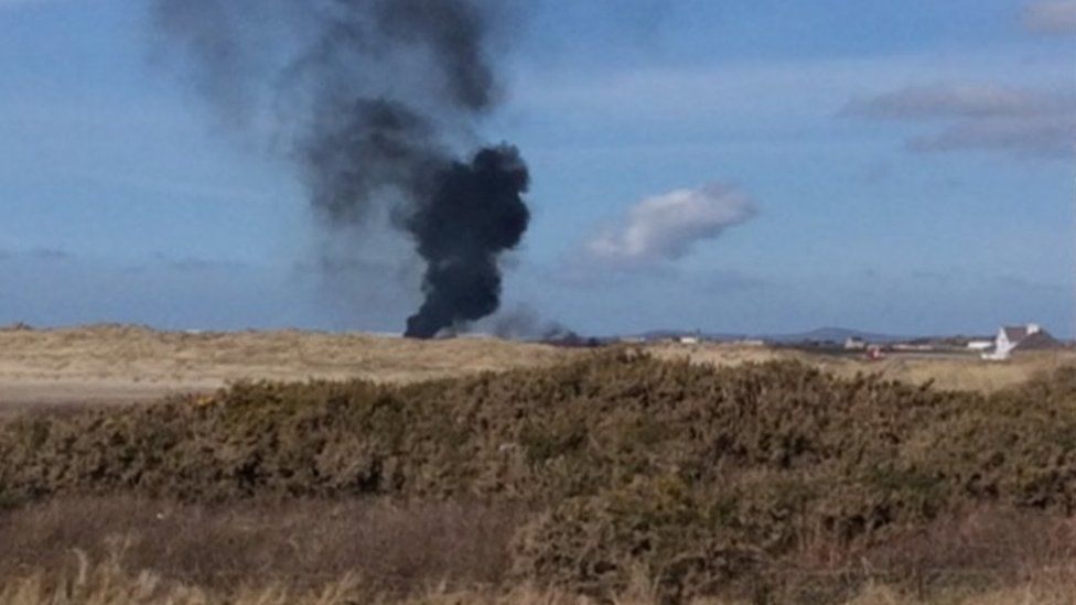 a plume of smoke seen coming from the RAF Valley airfield