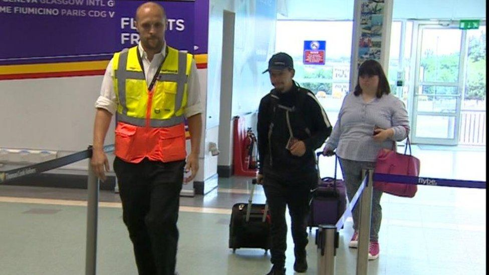 Jacques and Olivia of the Hijinx theatre pretend to be tourists to train airport staff in dealing with learning disabled customers