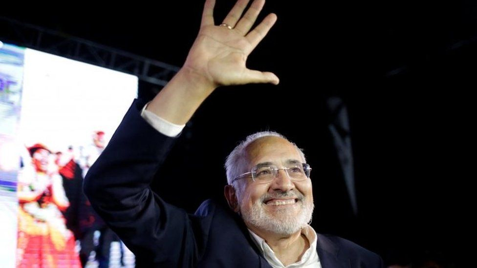 Bolivian presidential candidate Carlos Mesa waves following the results of the first round in La Paz, Bolivia.