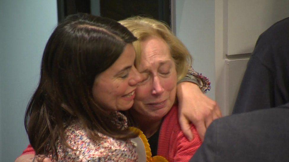 Former MP Sarah Olney embraces fellow Lib Dem activist