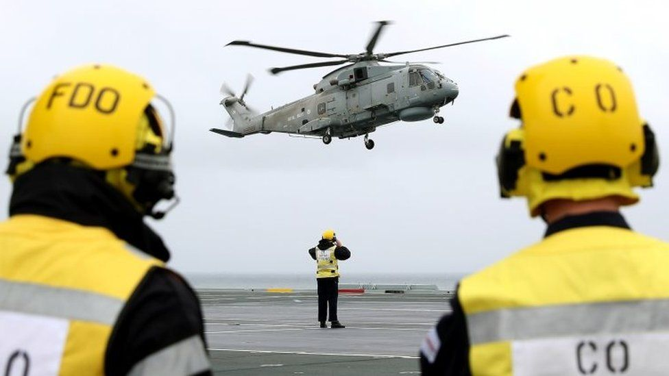 Michael Fallon arriving by helicopter