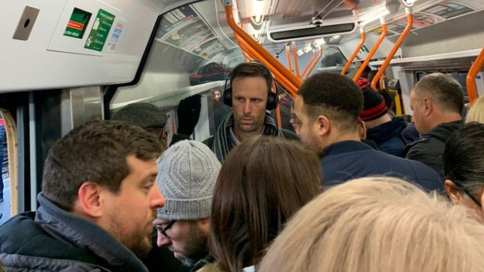 Commuters crowded on a South Western Railway train