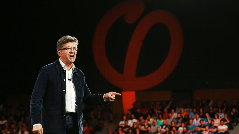 Jean-Luc Mélenchon gestures as he delivers a speech during a campaign rally on March 29, 2017 in Le Havre