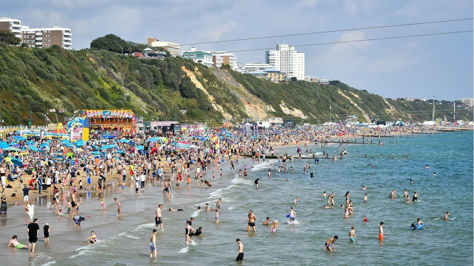 Thousands of people on the beach at Bournemouth in August 2018