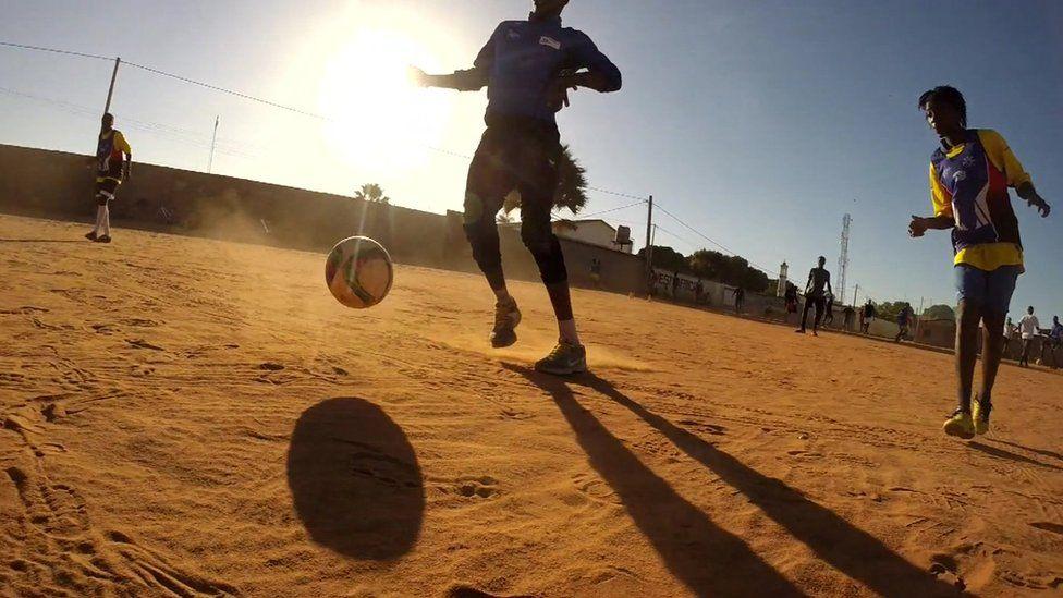 Gambian women playing football
