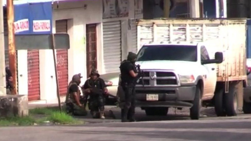 Armed people are seen in Culiacán, Sinaloa state, Mexico. Photo: 17 October 2019