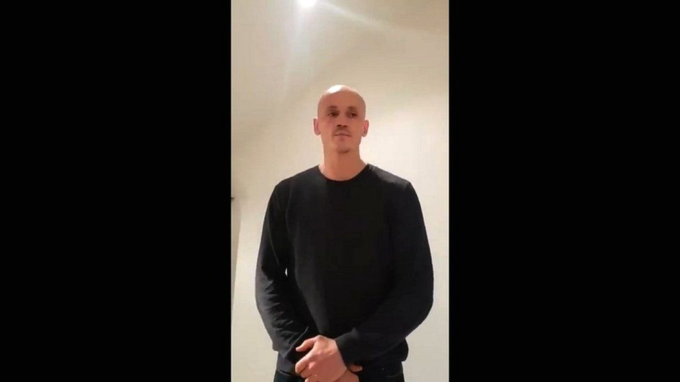 """A video grab made on 7 January 2019 shows former boxer Christophe Dettinger broadcasting a message of apology for punching police officers during a """"yellow vest"""" protest in Paris"""