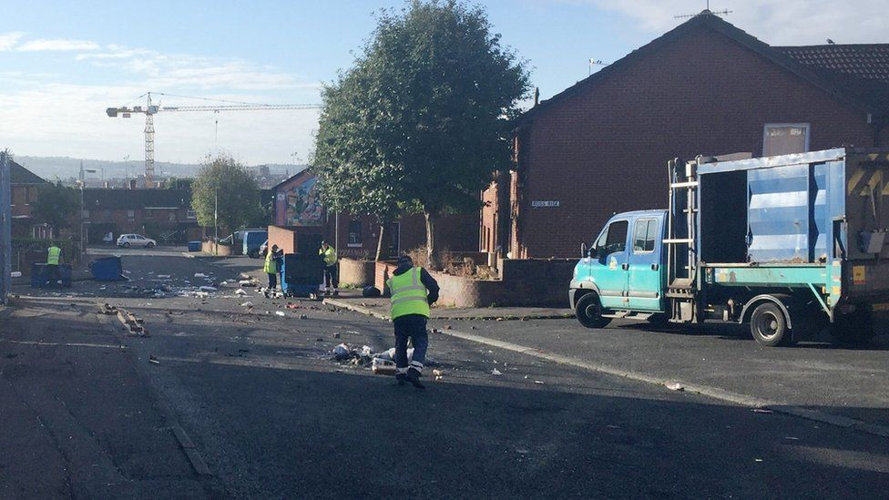 Belfast City Council workers cleaned up after a day of trouble in Belfast