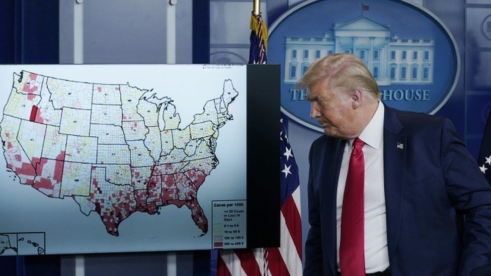 President Donald Trump with a map of US states affected by coronavirus at a White House briefing, 23 July 2020