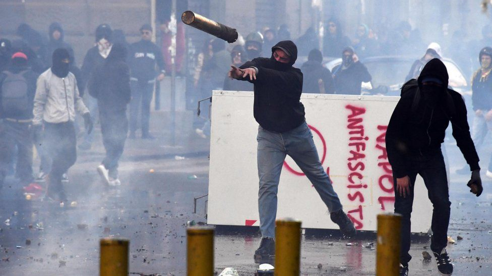 Protesters throw objects during clashes with riot police at a demonstration against the visit of the leader of the Northern League party Matteo Salvini, in Naples, Italy, 11 March 2017