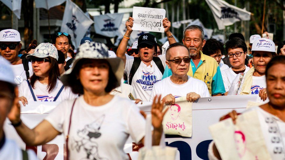 Supporters of Thailand's Prime Minister Prayut Chan-o-cha in pro-government walk at a park in Bangkok