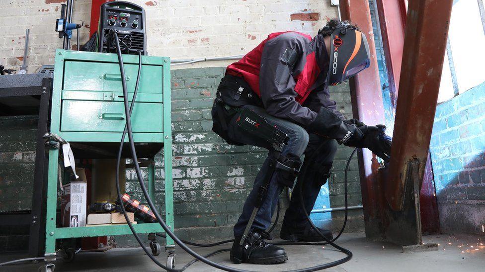 A man wearing a SuitX suit