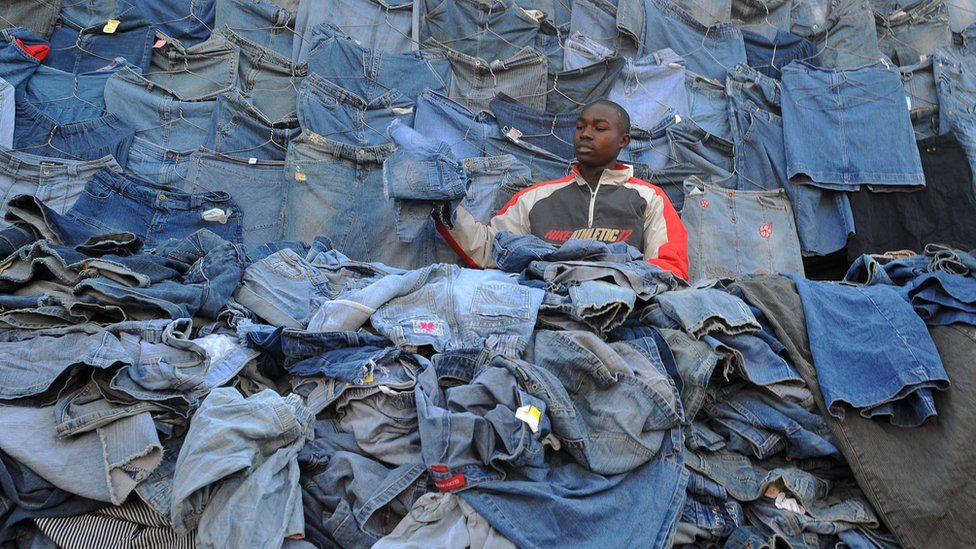 A Kenyan vendor waiting for customers sells second-hand clothes (locally known as mitumba) at the Gikomba open-air market on June 25, 2012, in Nairobi.