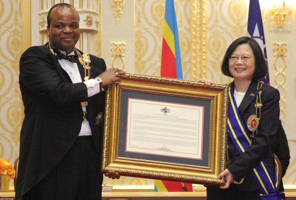 Swaziland absolute Monarch King Mswati III (L) poses with Taiwan President Tsai Ing-wen (R) after awarding her with the Order of the Elephant during her visit to the Kingdom of Swaziland at an official ceremony on April 18, 2018 in Lozitha Palace, Manzini.