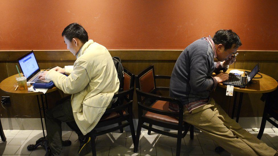 Men use the internet in a cafe in the Chinese capital Beijing in 2012.