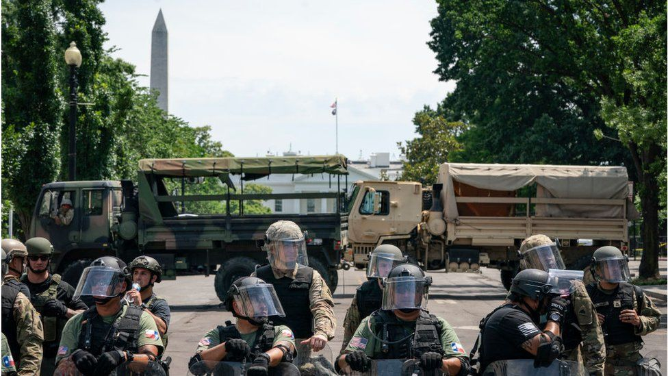 Police forces and National Guard vehicles are used to block 16th Street near Lafayette Park and the White House