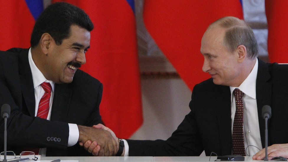 Russia's President Vladimir Putin (R) and his Venezuelan counterpart Nicolas Maduro shake hands during a signing ceremony at the Kremlin in Moscow, on July 2, 2013