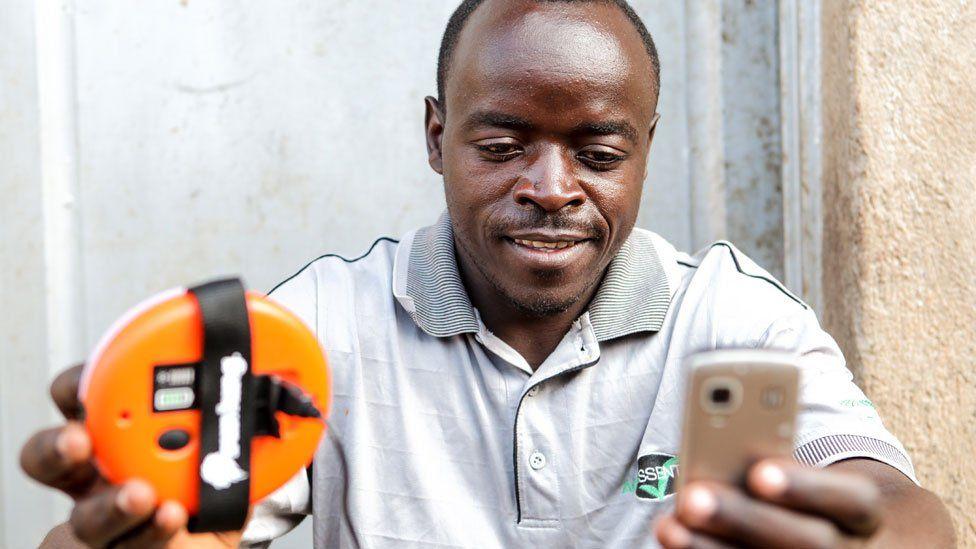 Rwandan man with charger